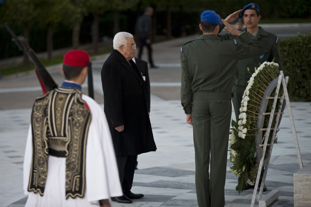 PA President Mahmoud Abbas pays tribute during a wreath laying ceremony at the Tomb of the Unknown Soldier in central Athens, on Monday, December 21, 2015 (AP Photo/Petros Giannakouris)