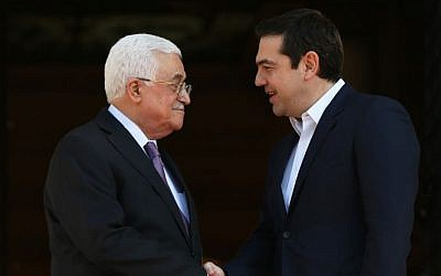 Greek Prime Minister Alexis Tsipras, right, shakes hands with President of the Palestinian Authority Mahmoud Abbas before their meeting in Athens,  December 21, 2015. (AP/Petros Giannakouris)