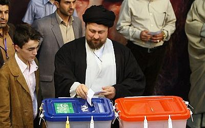 Hassan Khomeini casts his ballot in the 2013 Iranian elections. (CC BY-sayyed shahab-o-din vajedi via Wikimedia Commons)