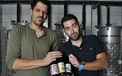 Herzl Beer partners Itai Gutman (left) and Maor Helfman in their Jerusalem brewery (Courtesy Mike Horton)
