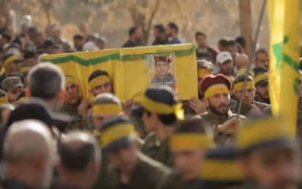 A Hezbollah funeral for one of its fighters killed in Syria. (YouTube/Channel 4 News)