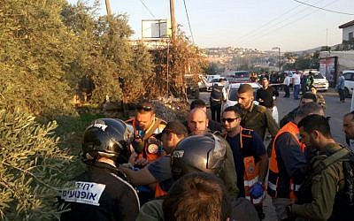 Rescue services at the scene of a car-ramming attack near the Beit Aryeh settlement in the West Bank on December 10, 2015 (United Hatzalah)