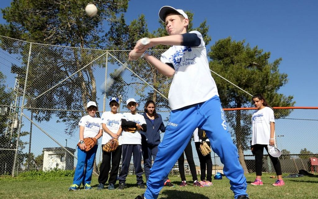 Up to bat in Baseball for All, an Israeli coexistence program (Courtesy Association of Baseball in Israel)