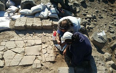 Archaeologists unearth a marble slab bearing a Hebrew inscription found on the shores of the Sea of Galilee at the Byzantine Jewish site of Kursi. (University of Haifa)