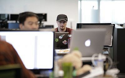 Brian Wallace, a security researcher at Cylance, works on his computer in Irvine, Calif. on October 21, 2015. (AP Photo/Jae C. Hong)