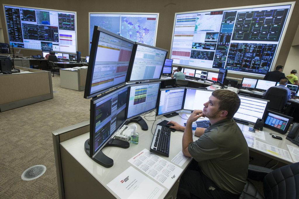 System control center operator Ryan Cox sits at his computer workstation at an AEP Transmission Operations Center in New Albany, Ohio on May 20, 2015. (AP Photo/John Minchillo)