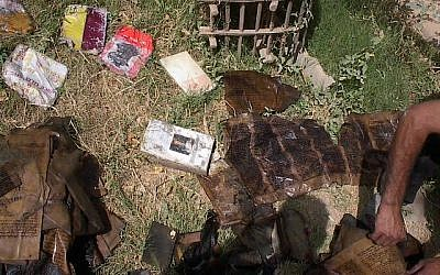 Books from the Jewish community of Iraq shown drying in the sun after their rescue from the flooded basement headquarters of Saddam Hussein's secret police on May 6, 2003, Baghdad, Iraq. (Courtesy: Harold Rhode)