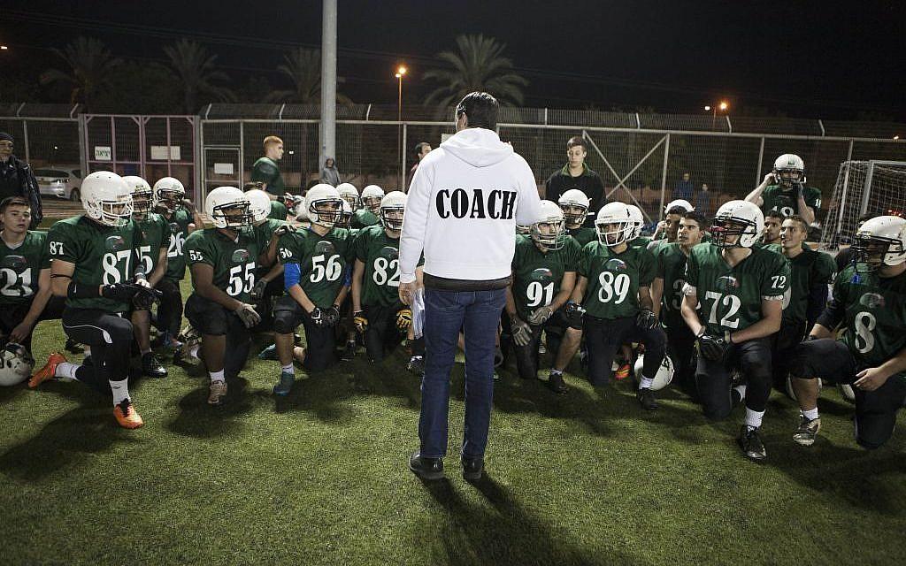 High school football team Kfar Saba Hawks players warm up for a game against Mazkeret Batya Gorillas in Kfar Saba, Israel, December 10, 2015. (Photo by AP Photo/Dan Balilty)