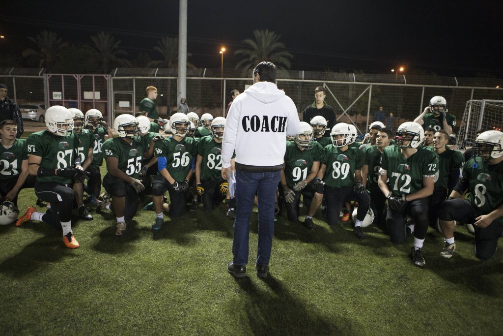 High school football team Kfar Saba Hawks players warm up for a game against Mazkeret Batya Gorillas in Kfar Saba, Israel, December 10, 2015. (Photo by AP Photo/Dan Balilty)