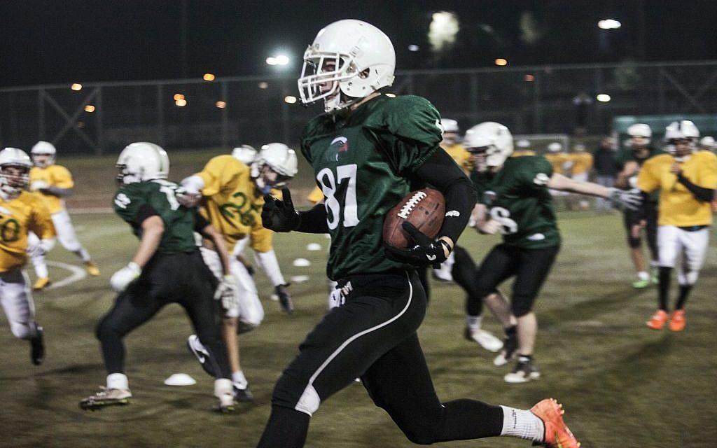 High school football team Kfar Saba Hawks,in green shirts, play against Mazkeret Batya Gorillas in Kfar Saba, Israel, December 10, 2015. (Photo by AP Photo/Dan Balilty)