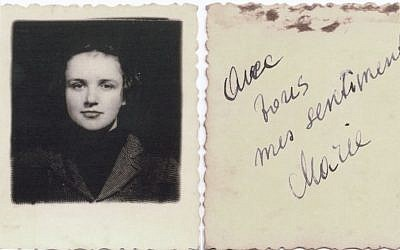 """This undated picture provided by Akira Kitade from an album owned by Tatsuo Osako, a former colleague of Kitade's at the Japan Tourist Bureau, shows a woman and an accompanying message on the back signed by Marie, reading """"avec tous mes sentiments"""" in French, or """"with all my affections."""" (Akira Kitade via AP)"""