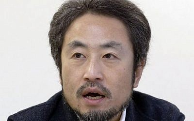 In this February 18, 2015 photo, Japanese freelance journalist Jumpei Yasuda speaks during an interview in Tokyo. (Kyodo News via AP)