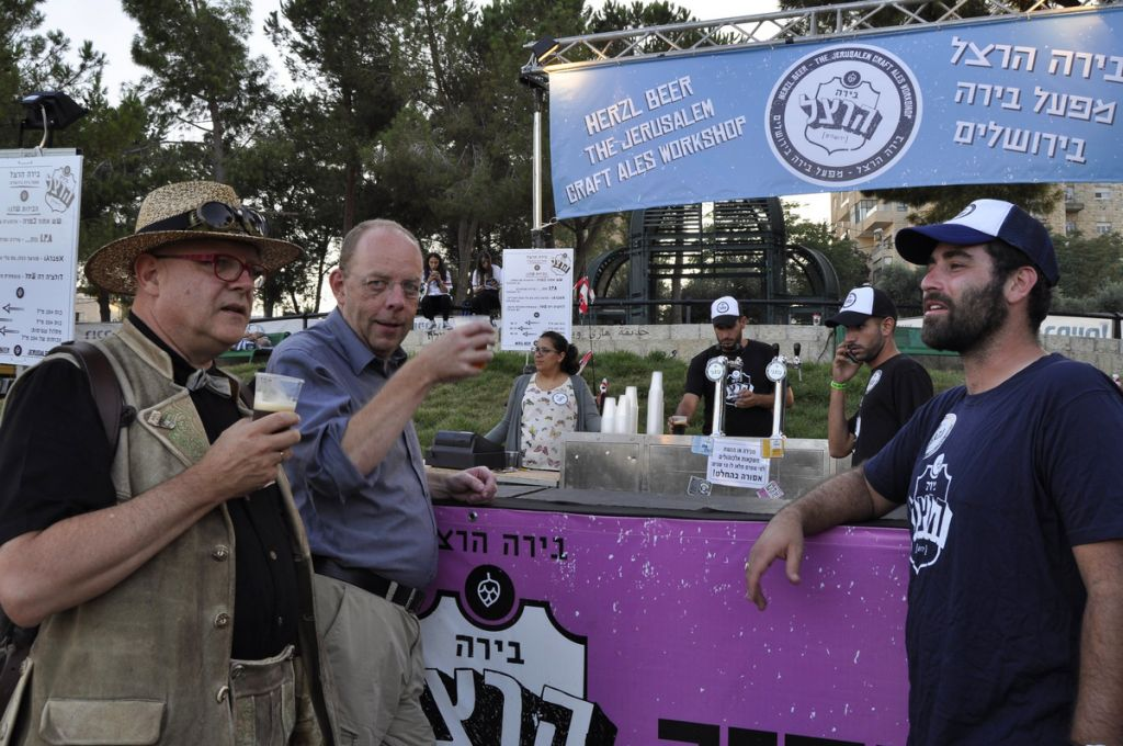 "Conrad Seidl, the ""Beer Pope"" (left) and Bernhard Purin met Herzl Beer's Maor Helfman (right) when they visited the Jerusalem Beer Festival last summer (Courtesy Mike Horton)"