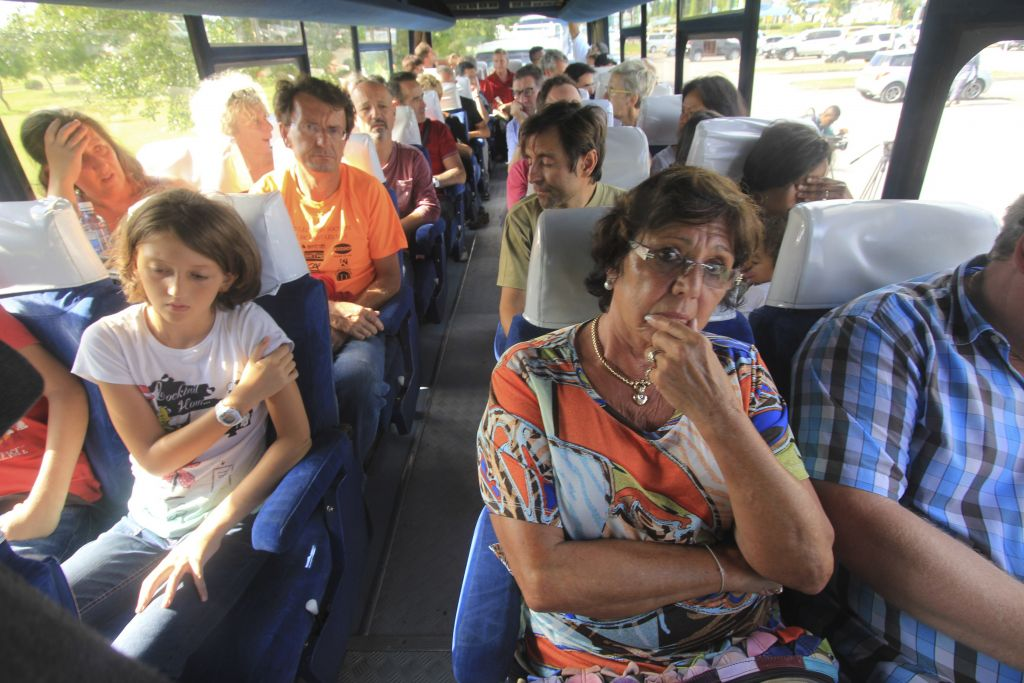 Passengers of an Air France plane which made an emergency landing at Moi International Airport ride on a bus after being evacuated from the plane in Mombasa on Sunday, Dec. 20, 2015. (AP Photo/Edwin Kana)