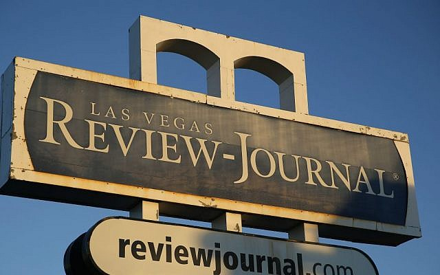 In this Thursday, Dec. 17, 2015, file photo, an exterior sign for the Las Vegas Review-Journal is seen in Las Vegas. (AP Photo/John Locher, File)