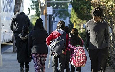 Parents pick up their children from school early, on Tuesday, Dec. 15, 2015, in Los Angeles. (AP Photo/Ringo H.W. Chiu)