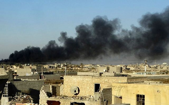 In this Friday, Dec. 25, 2015 photo, smoke rises from Islamic State positions following a US-led coalition airstrike as Iraqi security forces advance their position in downtown Ramadi, 70 miles (115 kilometers) west of Baghdad, Iraq. (AP Photo)