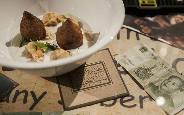 This Tuesday, Dec. 8, 2015 photo shows Shishbarak dish made by the Israeli Arab chef Johnny Goric during a Palestinian food Festival in Haifa, Israel. (AP Photo/Dan Balilty)