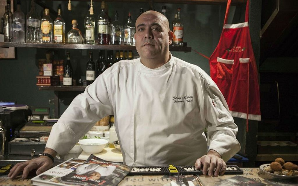 In this photo taken Tuesday, Dec. 8, 2015, Israeli Arab chef Johnny Goric poses during a Arab Food Festival in Haifa, Israel. (AP Photo/Dan Balilty)