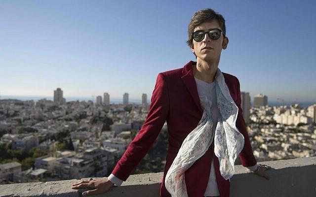 In this Wednesday, Dec. 9, 2015 photo, Iranian poet Payam Feili poses for a photograph in Tel Aviv, Israel. (AP Photo/Dan Balilty)