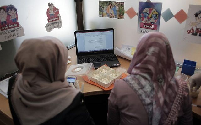 Illustrative: Palestinian entrepreneurs brainstorm ideas as they compete for acceptance in the third version of Mobaderoon project, hosted by the Islamic University's Business and Technology Incubator in Gaza City on November 24, 2015. (Khalil Hamra/AP Photo)