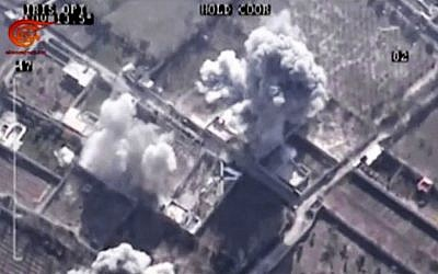 File: This image made from video made available on Saturday, Dec. 26, 2015, by Al-Mayadeen, a government-controlled Syrian television outlet, shows drone footage allegedly showing Syrian army airstrikes targeting Zahran Allouch, the head of the Army of Islam group near Damascus, Syria. (Al-Mayadeen via AP video)