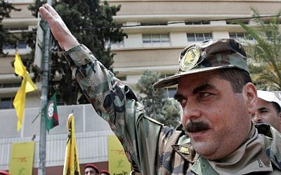 Samir Kuntar salutes as he arrives to pay his respects at the grave of Hezbollah commander Imad Mughniyeh, south of Beirut, Lebanon, on July 17, 2008. (AP/Darko Bandic, File)