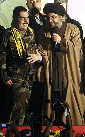 In this July 16, 2008, file photo, Hezbollah leader Hassan Nasrallah, right, gestures as he stands with Samir Kuntar during celebrations in Beirut of Kuntars release from Israeli jail. (AP Photo/File)