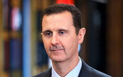 Syrian President Bashar Assad speaks during an interview with Venezuela's state-run Telesur network, in Damascus, Syria, September 25, 2013. (AP/SANA)