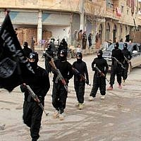 Image posted on a militant website on January 14, 2014, shows Islamic State fighters marching in Raqqa, Syria. (AP/Militant Website)