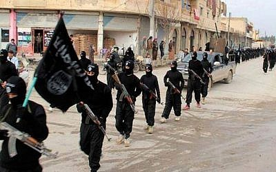 Undated file image posted on a militant website on January 14, 2014, shows Islamic State fighters marching in Raqqa, Syria. (AP/Militant Website)