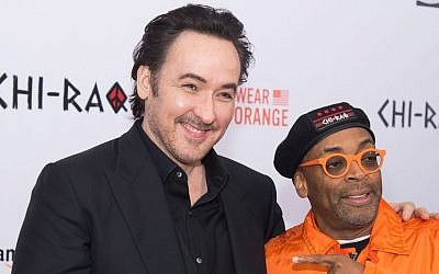 "John Cusack, left, and Spike Lee attend the premiere of ""Chi-Raq"" at the Ziegfeld Theatre, December 1, 2015, New York. (Charles Sykes/Invision/AP)"