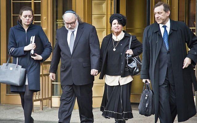 Jonathan Pollard, second from left, leaves federal court Monday, Dec. 14, 2015, in New York. (AP/Bebeto Matthews)