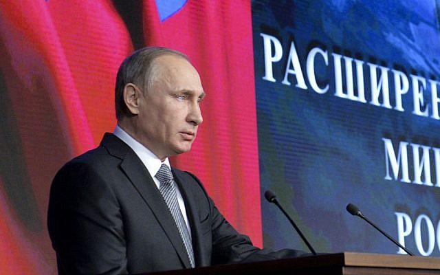 Russian President Vladimir Putin at a meeting with top military officials in Moscow, Russia, Friday, Dec. 11, 2015. (Alexei Druzhinin/Sputnik, Kremlin Pool Photo via AP)