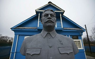 In this Wednesday, December 9, 2015 photo, a bust of Soviet leader Josef Stalin stands on the front lawn of a house-turned-museum in the village of Khoroshevo, west of Moscow, Russia. (AP/Pavel Golovkin)