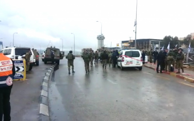 IDF troops, police and paramedics at the scene of an attempted stabbing at the Gush Etzion Junction on December 1, 2015 (Magen David Adom)
