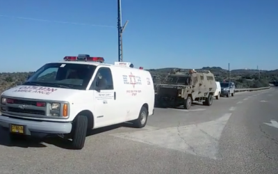 Army and Magen David Adom medics arrive on the scene of a stabbing attack near the West Bank settlement of Halamish on December 4, 2015. (Magen David Adom)