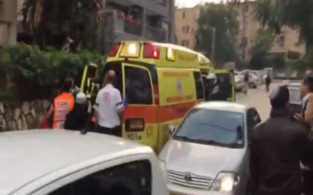 Paramedics at the scene of a stabbing on Anielewicz Street in Ra'anana on December 19, 2015. (screen capture: Channel 2)