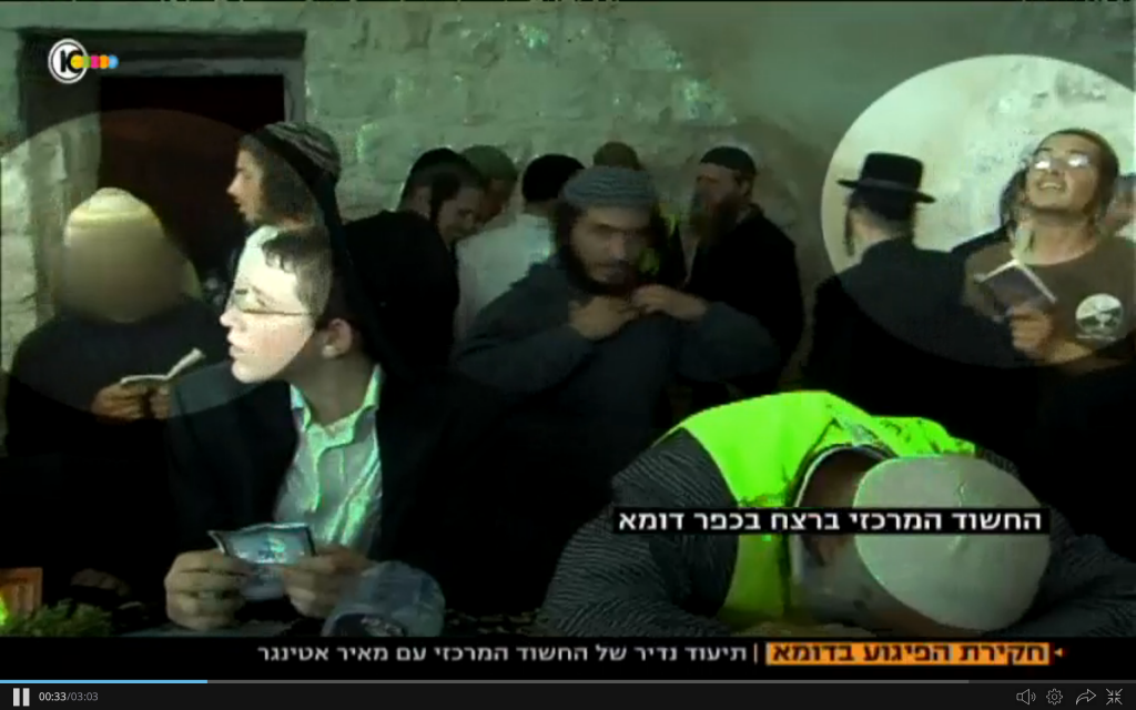 The main suspect in the Duma terror case, circled at left, praying at Joseph's Tomb alongside Meir Ettinger, another Jewish extremist held by the Shin Bet. (screen capture: Channel 10)