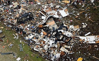 Debris of homes spread out after Saturday's tornado in Garland, Texas, Sunday, Dec. 27, 2015. (Photo by G.J. McCarthy/The Dallas Morning News via AP)