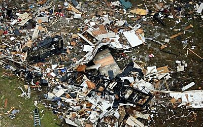 Debris of homes spread out after Saturday's tornado in Garland, Texas, Sunday, Dec. 27, 2015. (G.J. McCarthy/The Dallas Morning News via AP)