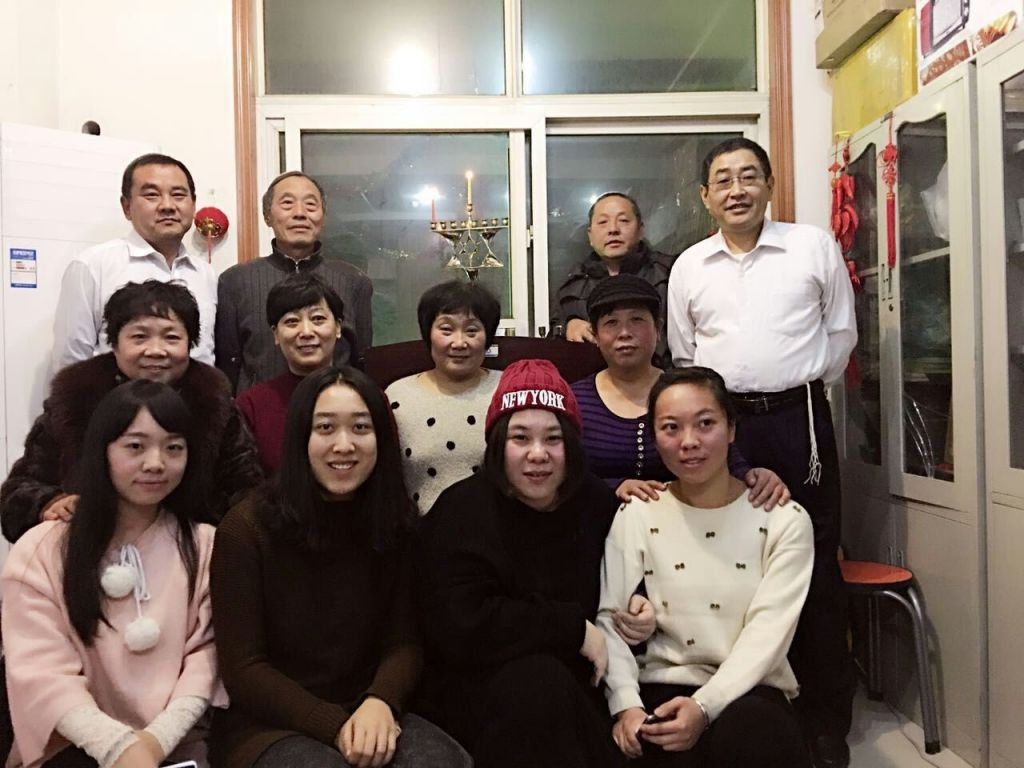 Members of the Kaifeng Chinese Jewish community on the first night of Hanukkah, December 6, 2015. (Shavei Israel)