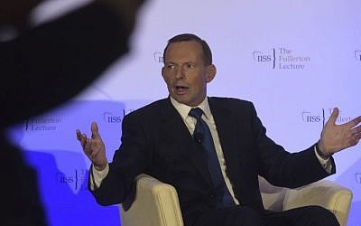 Former Australian prime minister Tony Abbott responds during a question and answer session after delivering a lecture at the Fullerton Hotel in Singapore on December 9, 2015 (Photo by AP Photo/Joseph Nair)