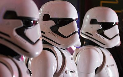 """Fans wearing Storm Trooper costumes ahead of the first public screening of """"Star Wars: The Force Awakens"""" at TOHO Cinemas in Tokyo, Japan, Dec. 18, 2015. (Tomohiro Ohsumi/Bloomberg/Getty Images/JTA)"""