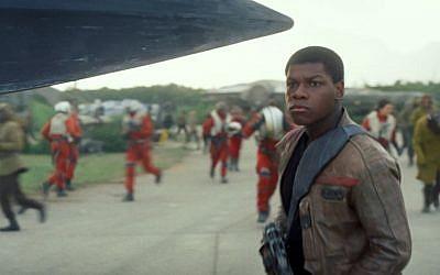 "This photo provided by Disney shows John Boyega as Finn, in a scene from the new film, ""Star Wars: The Force Awakens,"" directed by J.J. Abrams. (Film Frame/Disney/Lucasfilm via AP)"