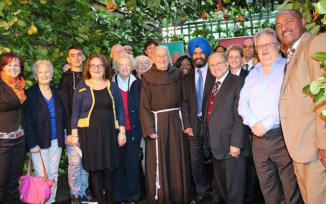 Chief executive of Liberal Judaism in the UK Rabbi Danny Rich (second from right) in 'Season of Sanctuary' sukkah in Redbridge, October 2014. (Citizens UK)