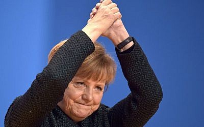 German Chancellor and chairwoman of the Christian Democrats, CDU, Angela Merkel, thanks delegates for their standing ovations after a speech at the party convention in Cologne, Germany.  (AP Photo/Martin Meissner, File)