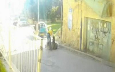Abdel Rahman Masawda, in yellow shirt, stabs an IDF soldier on Wednesday, December 12, 2015. (Screen capture)