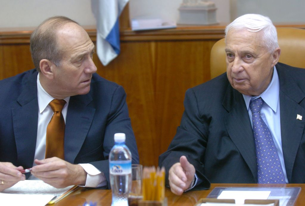 Prime minister Ariel Sharon sits beside Ehud Olmert at a cabinet meeting in the Prime Minister's office, September 26, 2004 (Sharon Perry/Flash 90)