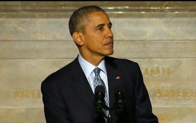 US President Barack Obama speaking to 31 new US residents during the naturalization ceremony at the National Archive in Washington DC, on December 15 2015. (Screen capture)